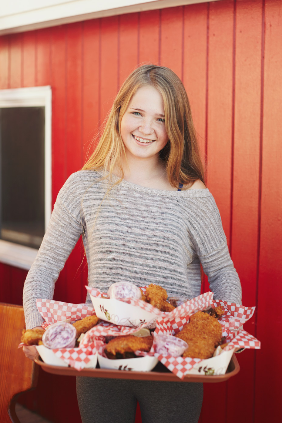 Stacey Van Berkel Photography I Young blonde girl holding huge tray of fish and chips I Richard's Seafood I Covehead Wharf, Prince Edward Island, Canada