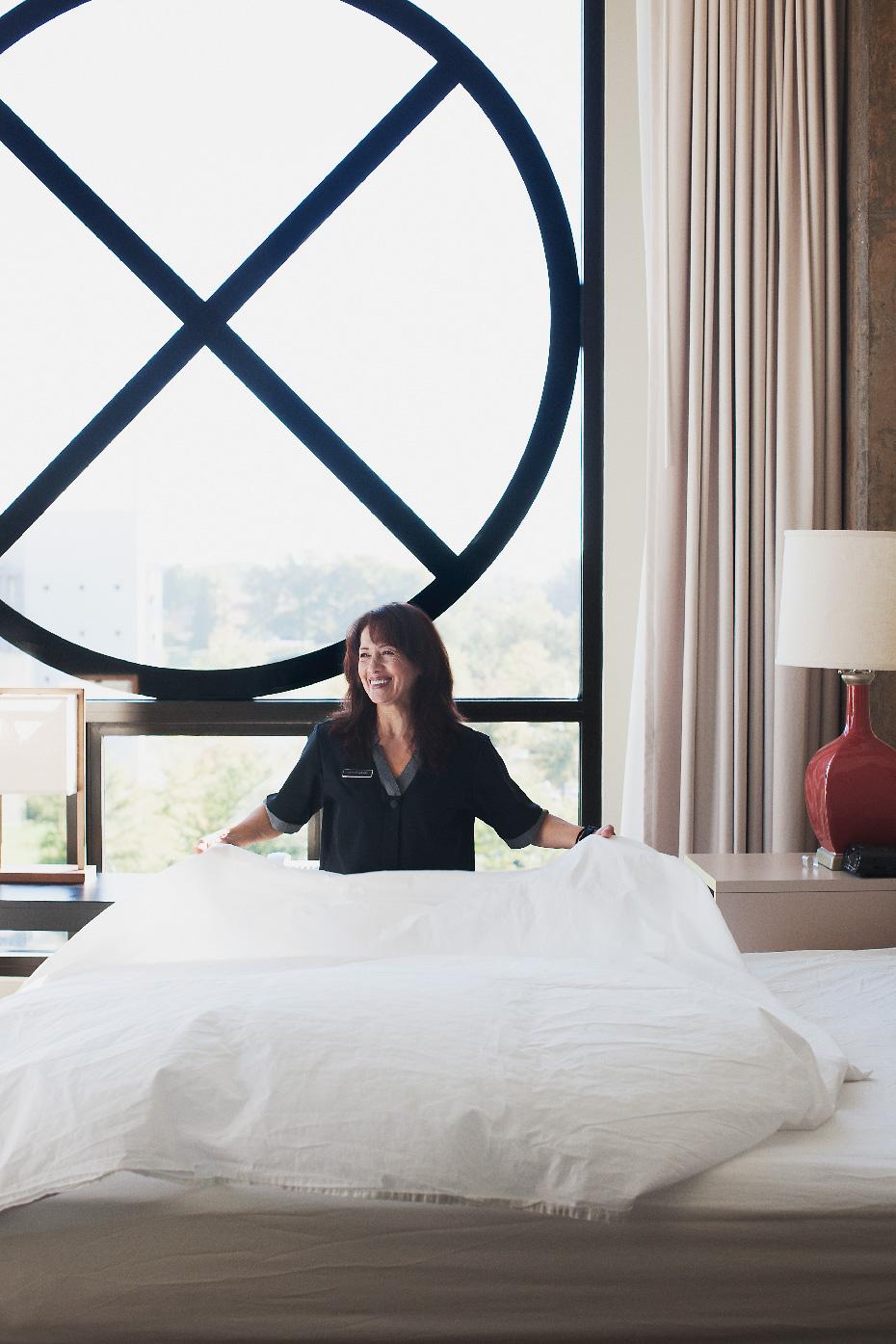Stacey Van Berkel Photography I Maid making bed at beautiful Proximity Hotel I Greensboro, North Carolina