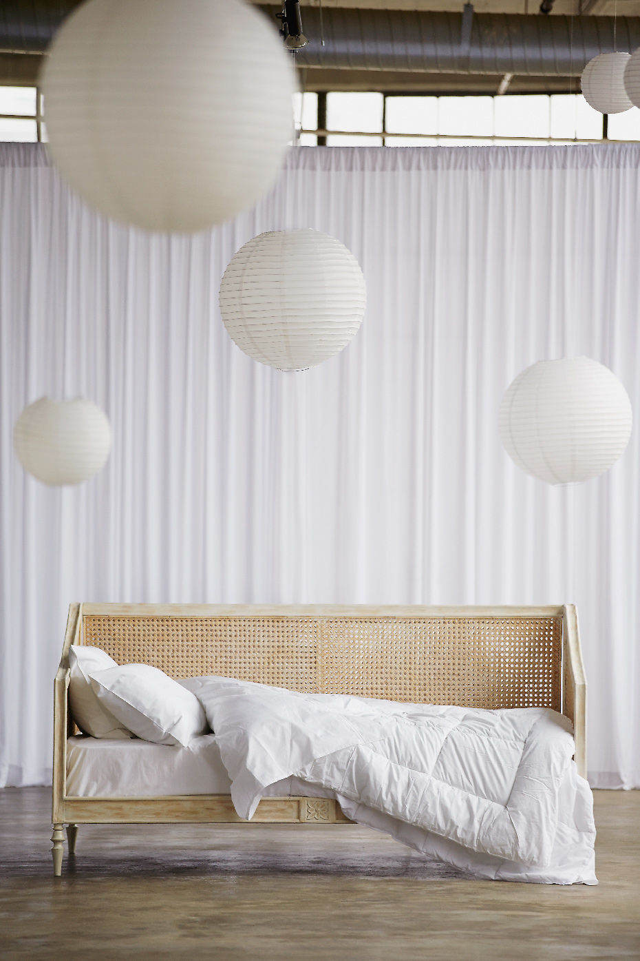 Stacey Van Berkel Photography I Rattan daybed with dreamy white duvet and pillows I Palu Furniture