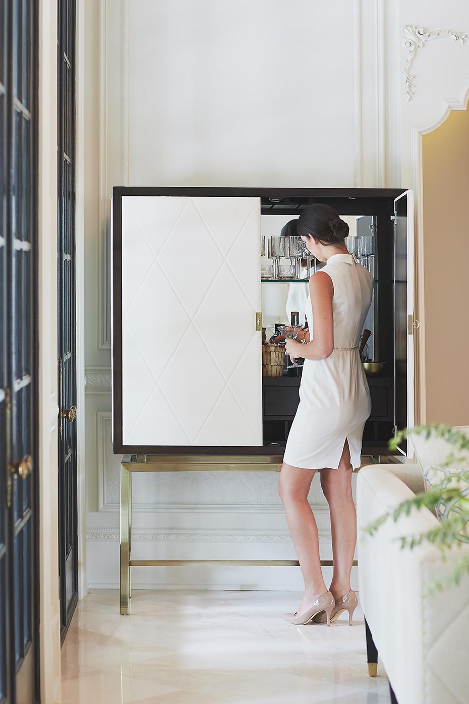 Stacey Van Berkel Photography I Elegant woman opening Bar I Luxury I White on white I Parisian apartment I Bernhardt Furniture