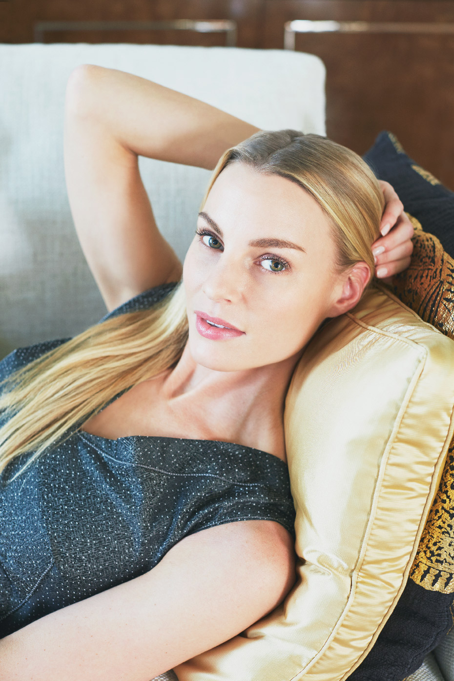 Stacey Van Berkel Photography I Chic blonde woman lying on sofa I Bernhardt Furniture