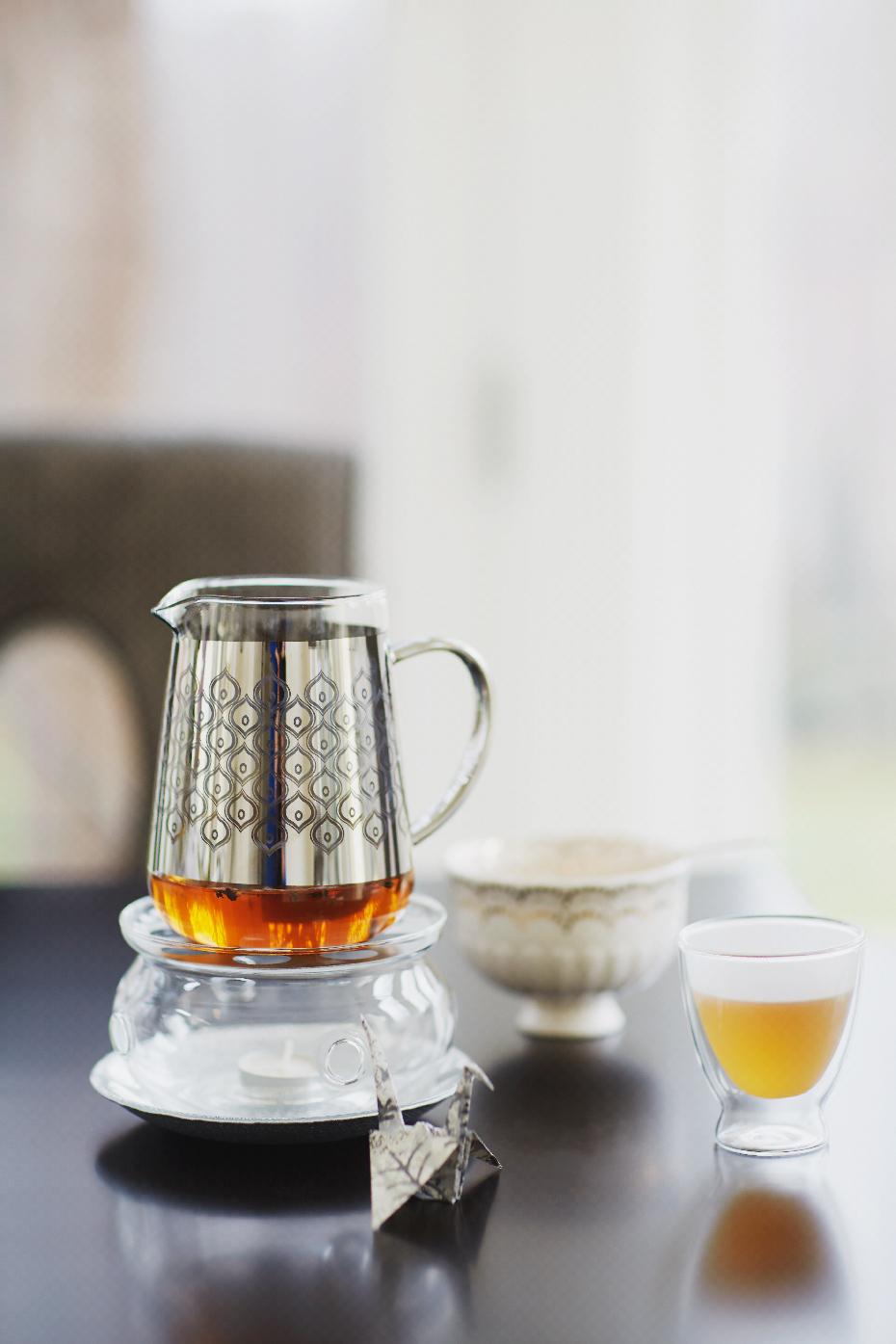 Stacey Van Berkel Photography I Ornate tea pot with tea I Bernhardt furniture