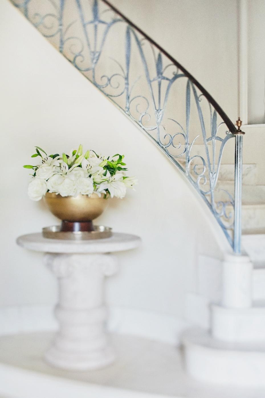 Stacey Van Berkel Photography I Elegant spiral staircase with flower arrangement I Bernhardt Furniture