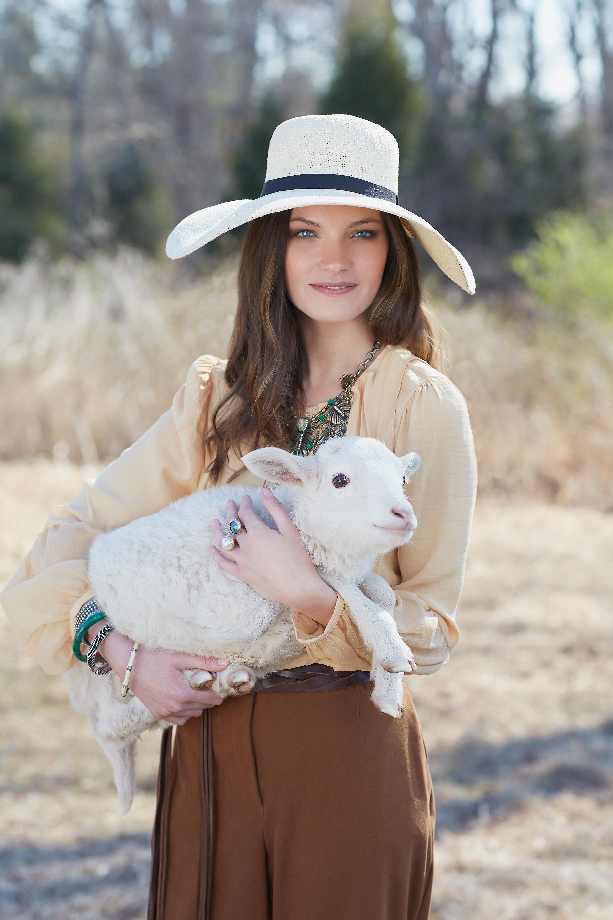 Fashionable Farmer : holding a lamb