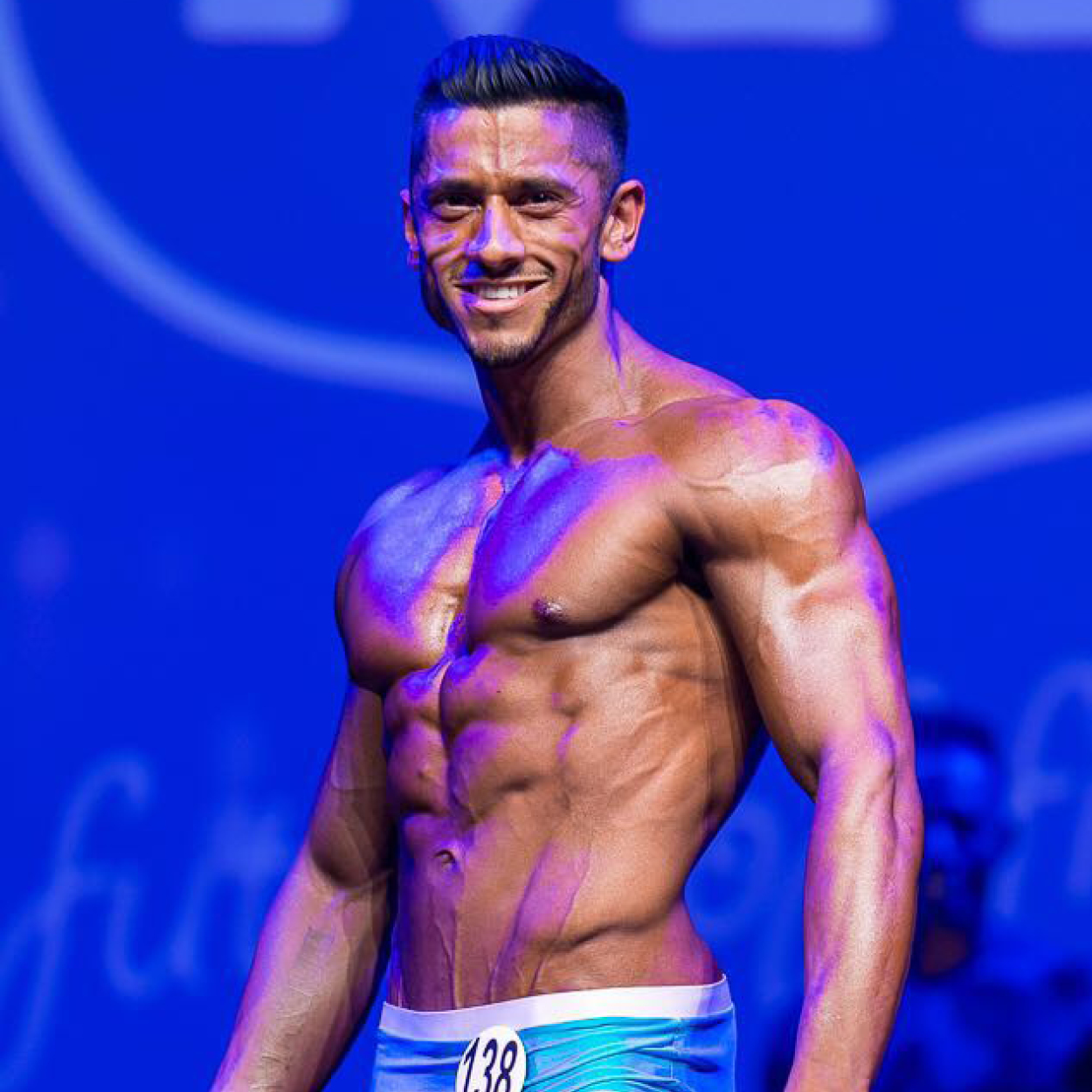"""OMAAD NAZIR   """"Ever since I started taking my training seriously in January 2013, I had a clear goal to one day step on stage and compete. At the time I knew nothing about competing, the federations, the different categories in each competition or what judges are looking for. However what I did know was in order for me to fulfil my dream of competing I wouldn't be able to do it alone and I would need professional help.  Having researched and trialled a number of different dieting and training methods over the years I noticed I wasn't getting the results I expected of someone who put in so much effort and followed very strict guidelines when it came to nutrition. I knew there was something missing, something I wasn't doing right, that's when I contacted Adam. I was always familiar with Adams work through social media and was inspired by what Adam had achieved and the success his clients had experienced in their competitions under Adams guidance. When we sat down and discussed my plans to compete and the methods we were going to use I knew straight away that Adam was the right man to get me in the shape of my life and get me stage ready.  We worked on a 12 week plan to the Miami Pro Competition and a further week for the Pure Elite Comp. During the 13 weeks I saw my body transform week by week with regular check ins and continuous support, I felt at ease throughout the whole prep knowing that I am in good hands with the expert advice and knowledge being passed on to me by Adam. Everything Adam anticipated would happen from changes to the diet and training splits was happening right before my eyes and I was left speechless at how knowledgeable my coach was. I followed the whole plan perfectly without cutting any corners, prepped all my meals to the gram, ate all my meals at the suggested times and trained exactly how I was instructed to focusing on hitting the target rep ranges and tempos.  Without Adams help and support I don't think I would have ever achieved what I """