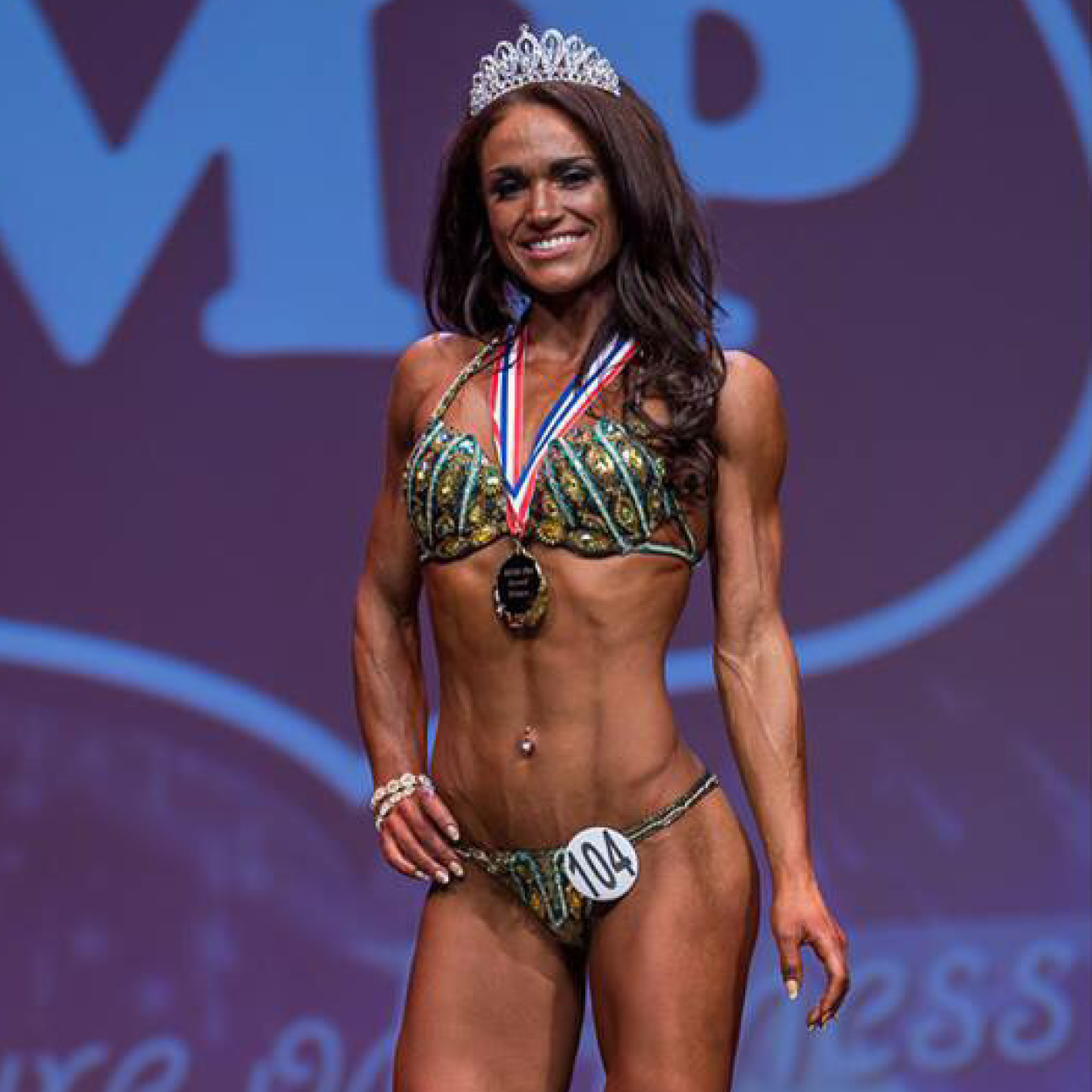"""MEISHA PIGGOTT   """"Having been in the fitness industry myself for more than 7 years, I have always been tempted to compete. Even with the knowledge I already had, I knew I couldn't do it alone. Cue Adam.  With experience and a career I aspire to and generally just an all round nice guy, I knew Adam would be the coach to help me achieve my goal. His knowledge relating to nutrition, supplementation and training is incredible and he easily applied it to me as an individual, considering my attitude, lifestyle and requirements. As I know he will agree, I am somewhat a perfectionist and like to ensure that I do everything by the book. Regardless of my endless questions and need for reassurance, Adam continued to pick me up and push me further than I ever thought was possible. Even managing to convince me to train less and relax more – unheard of in my world.  Now, with my first competition done and 6 Miami Pro trophies under my belt, the 'boss' (as I call him) and I have big plans for me over the coming year, and I honestly, couldn't be more honoured and proud to be working with him on the next goal. I know, together, we'll achieve what I want to achieve. I trust him 100%. Whatever the boss says, I will do!"""""""