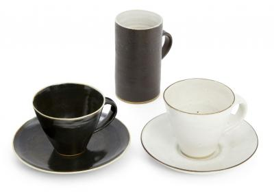 A group of Lucie Rie standard ware cups and saucers. Sold for £1600