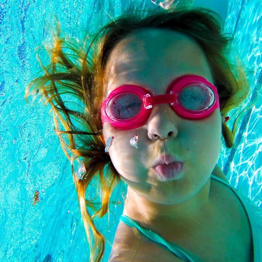 Underwater, holding her breath