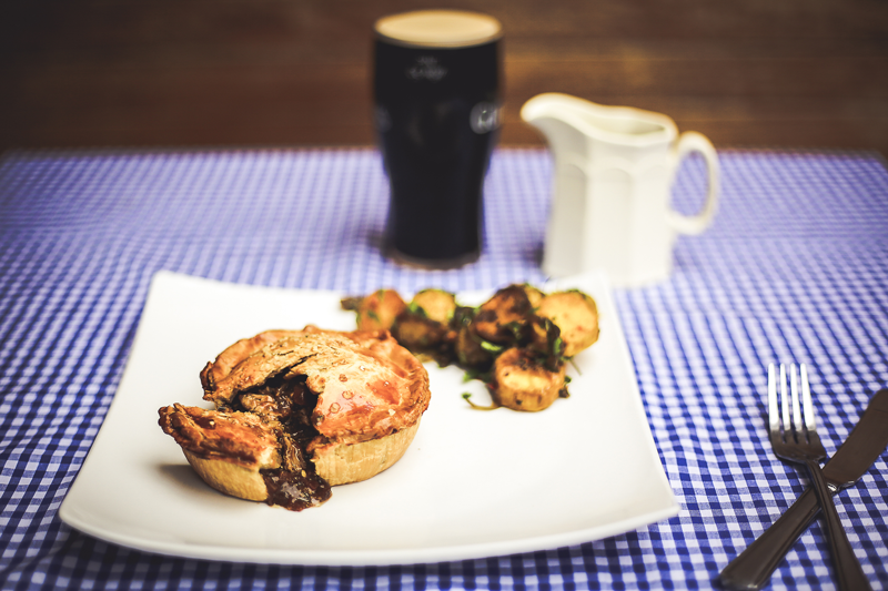 Pieman Dublin Pies pouring out with a pint of stout to accompany