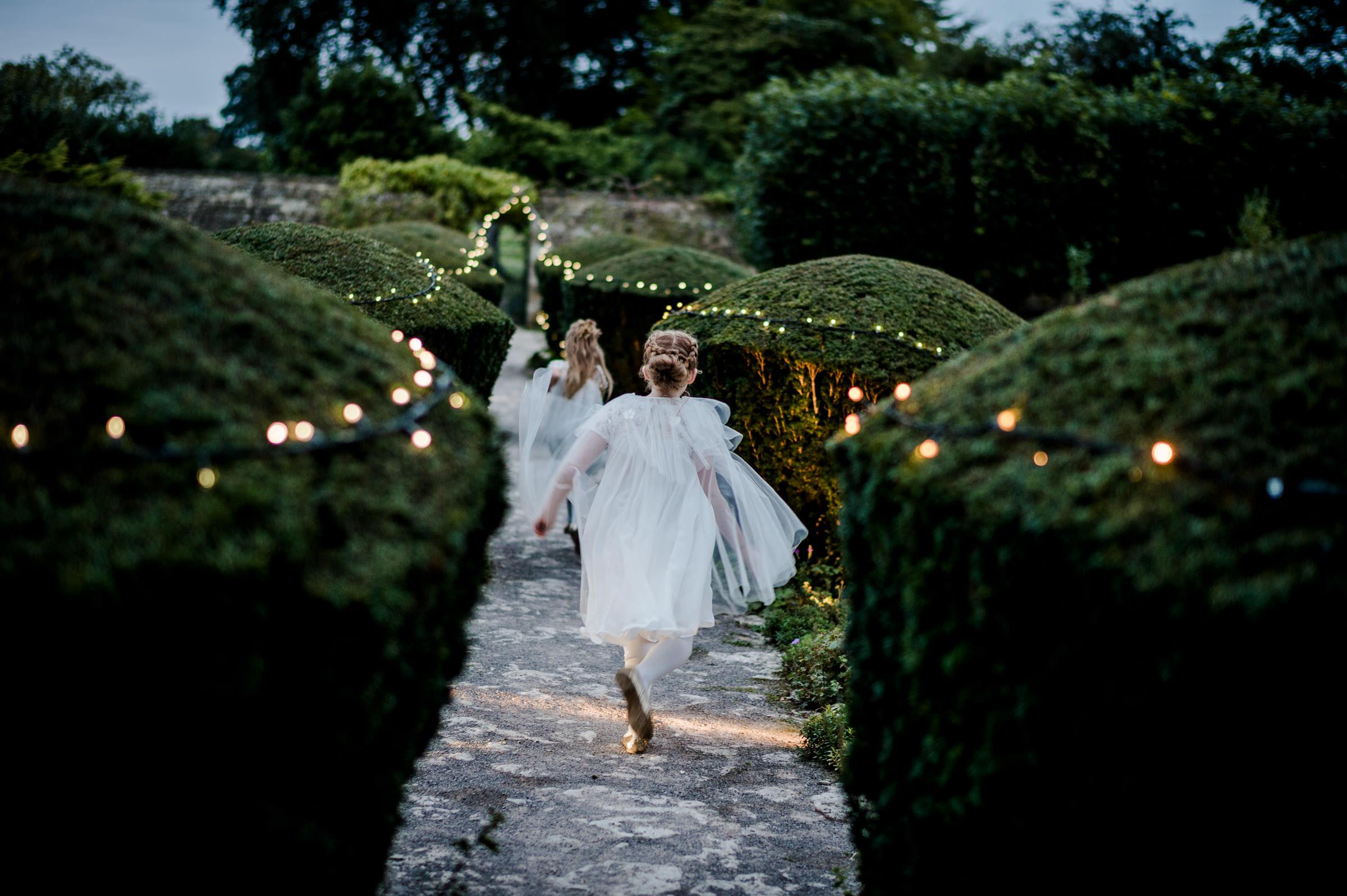 authentic photo of flowergirls running during dusk.jpg