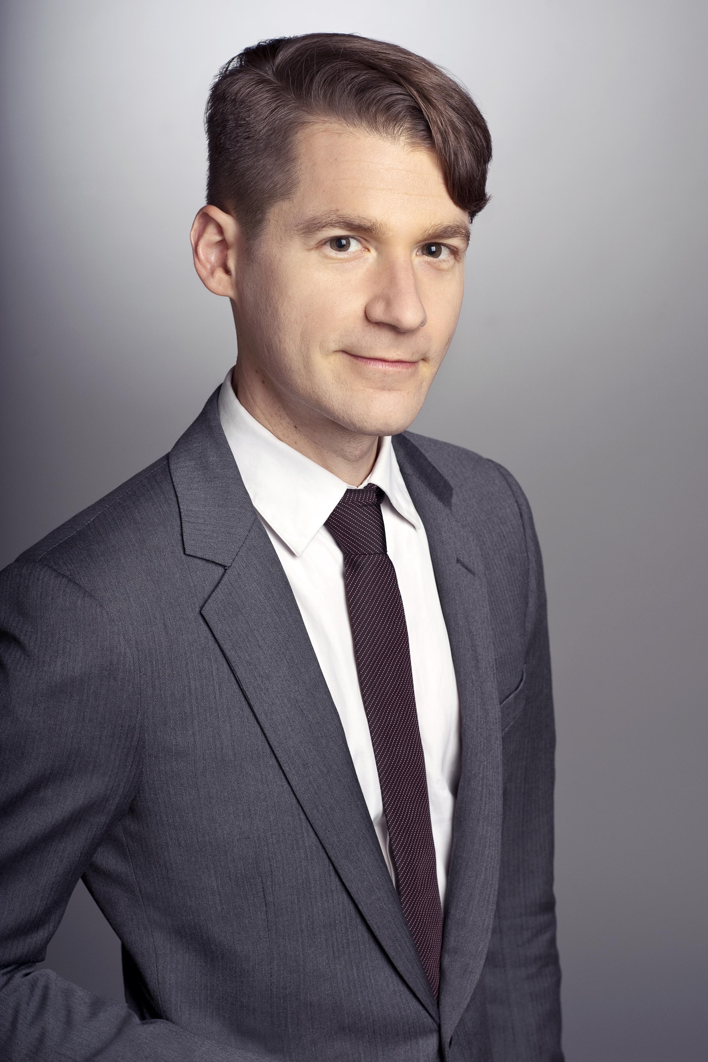 David Headshot Grey Suit Side Profile.jpg