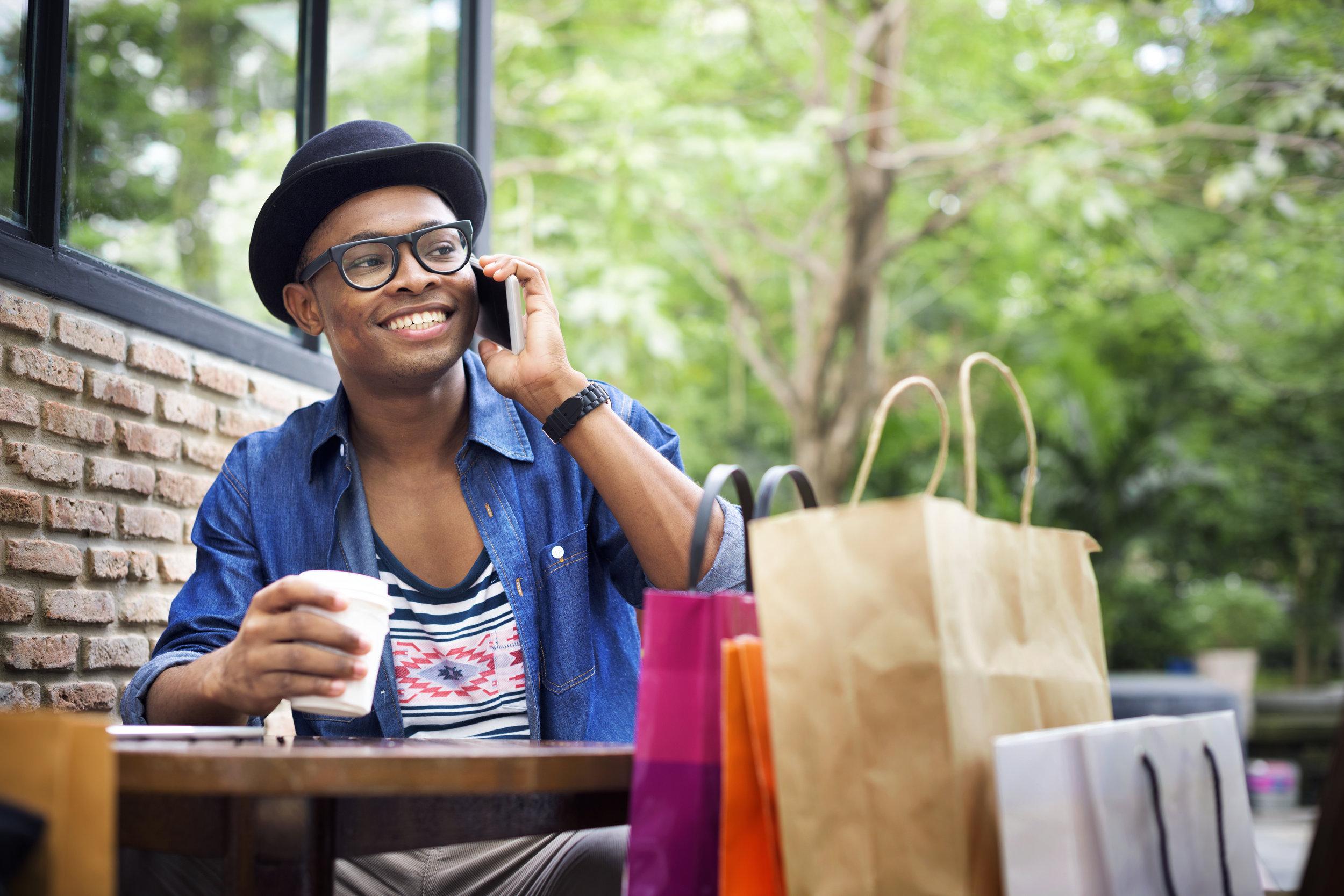 man-shopping-spending-customer-consumerism-PRNRSH9.jpg