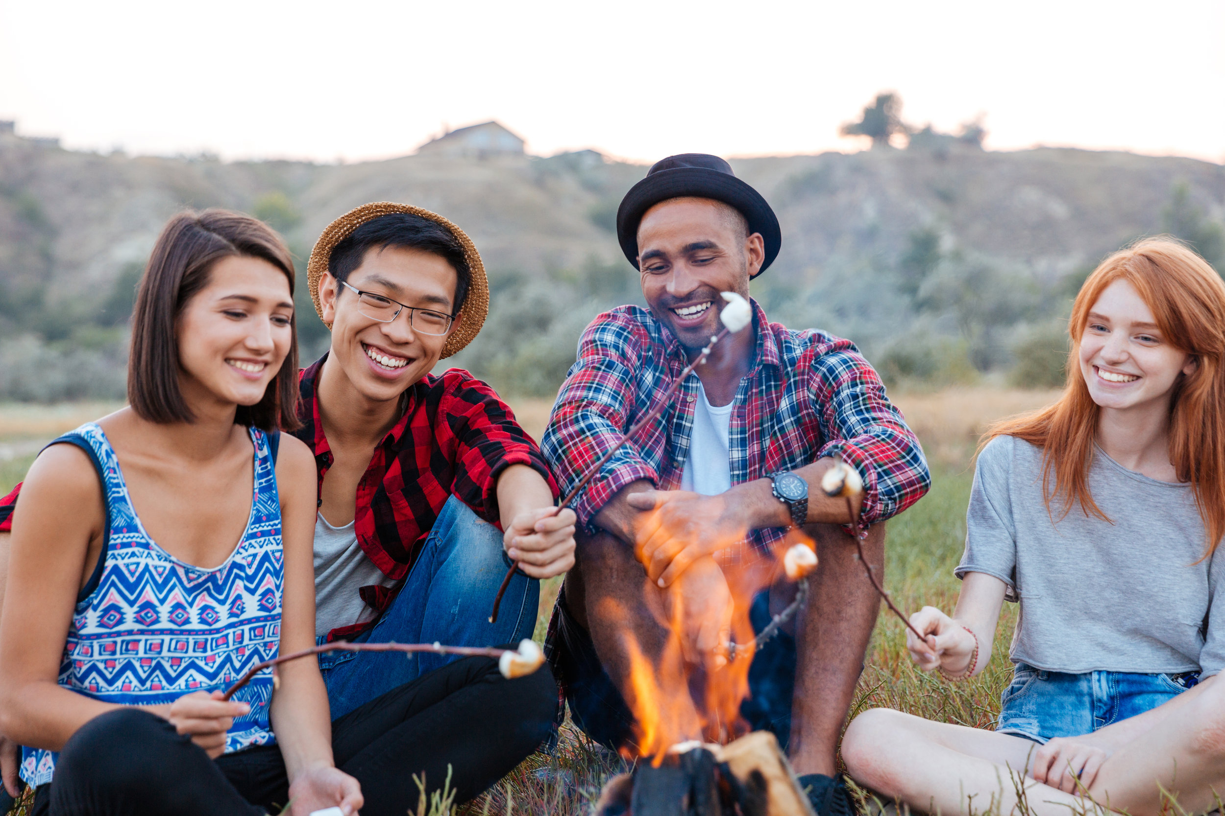 happy-young-people-sitting-and-roasting-PPZBVFU.jpg