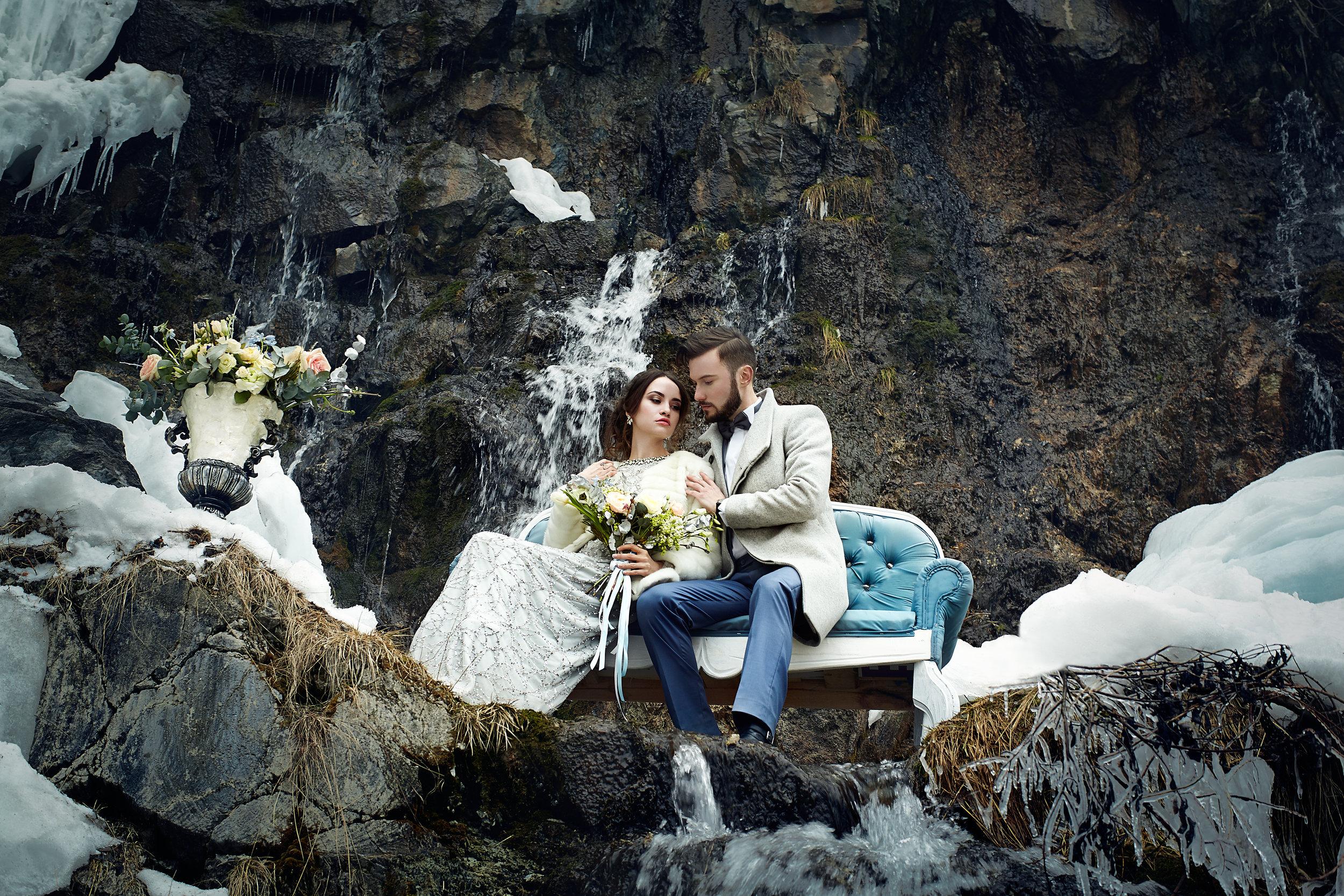 happy-couple-hugging-on-rock-on-the-background-of-PBMUMJ5.jpg
