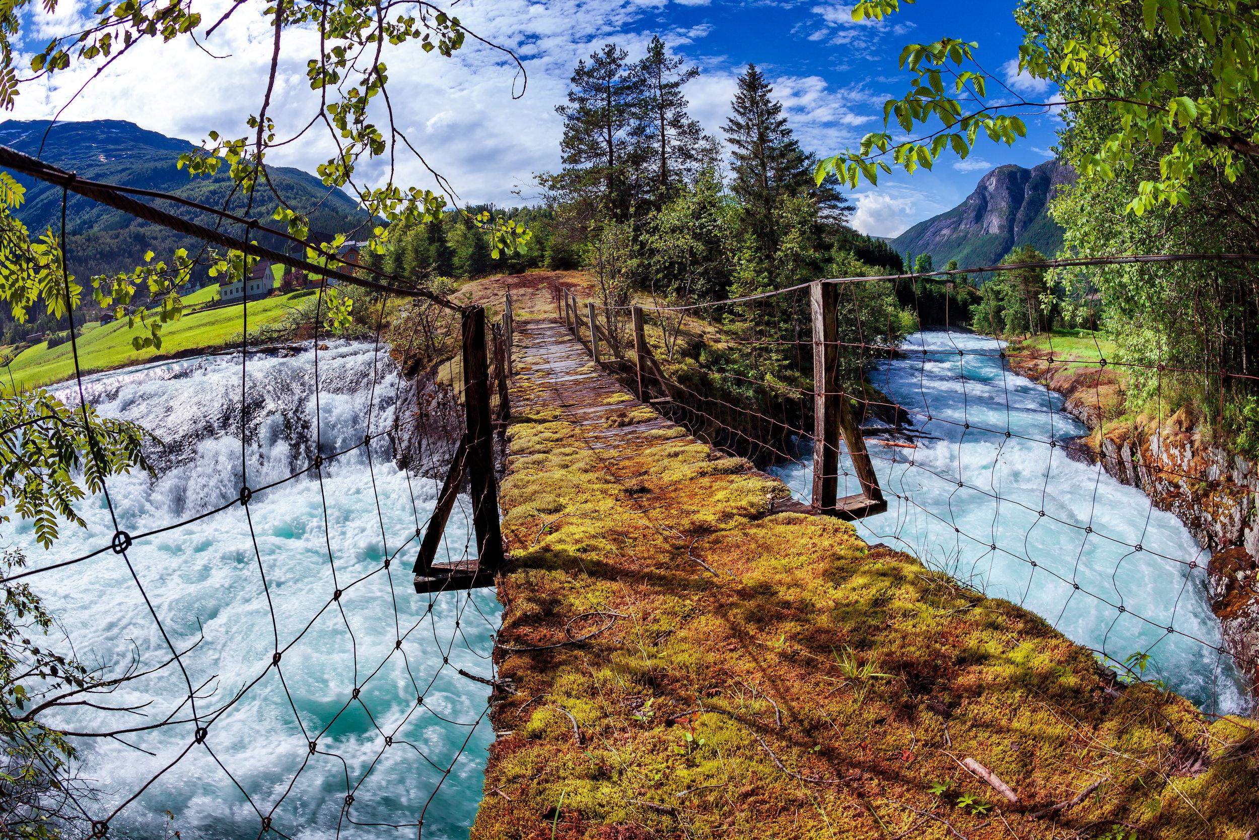 suspension-bridge-over-the-mountain-river-norway-P73JDMN.jpg