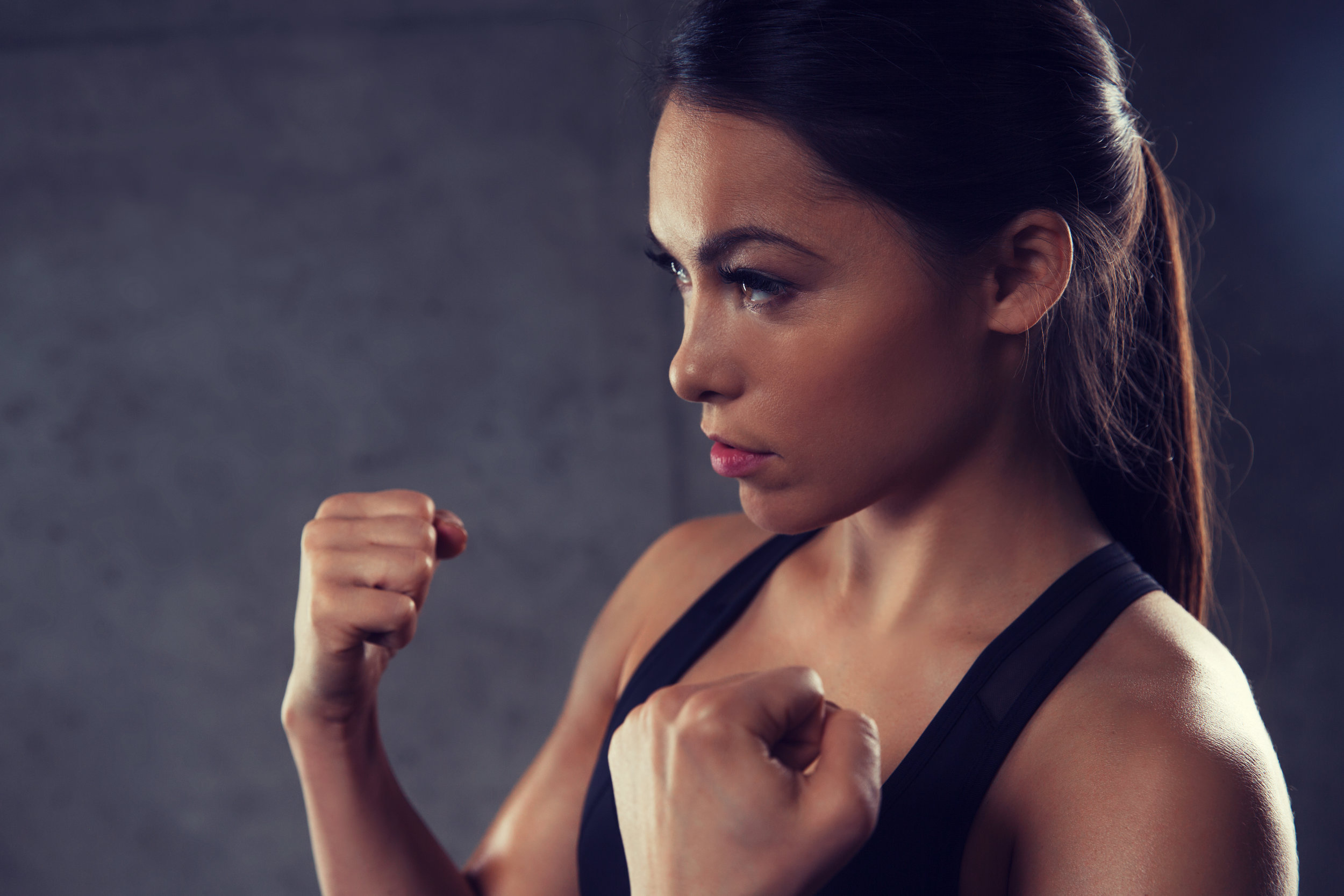 woman-holding-fists-and-fighting-in-gym-PR6KQU8.jpg