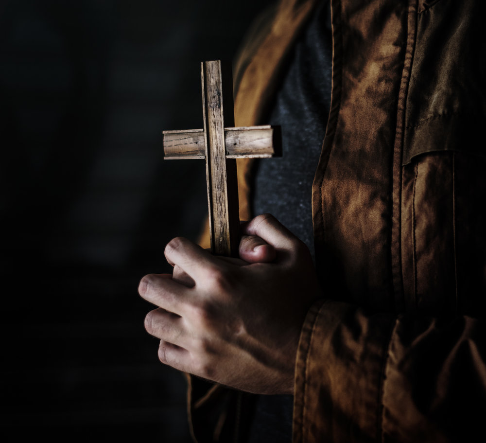 adult-woman-hands-holding-cross-praying-for-god-PDGHXS2.jpg