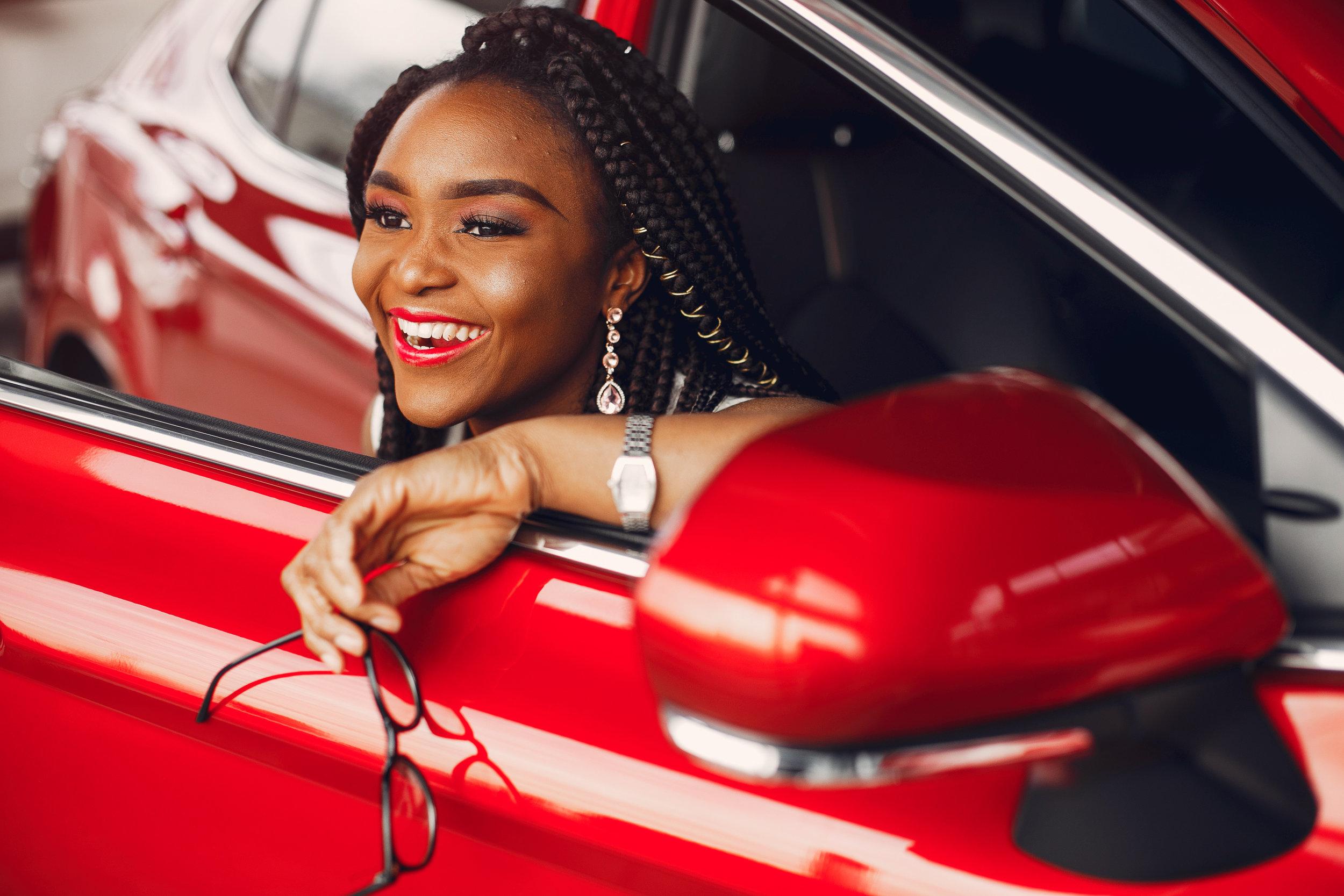 stylish-black-woman-in-a-car-salon-KFHM2B8.jpg