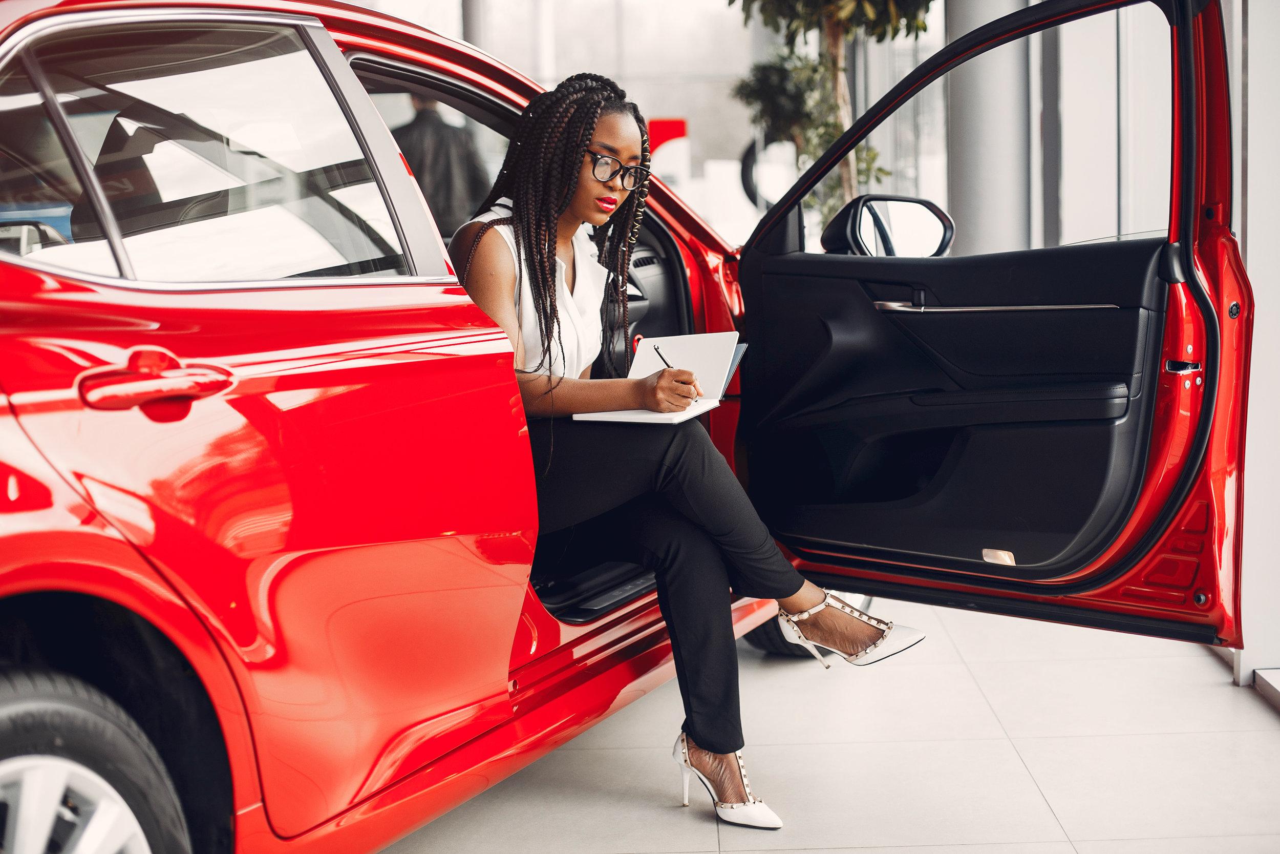 stylish-black-woman-in-a-car-salon-SGKXCD8.jpg