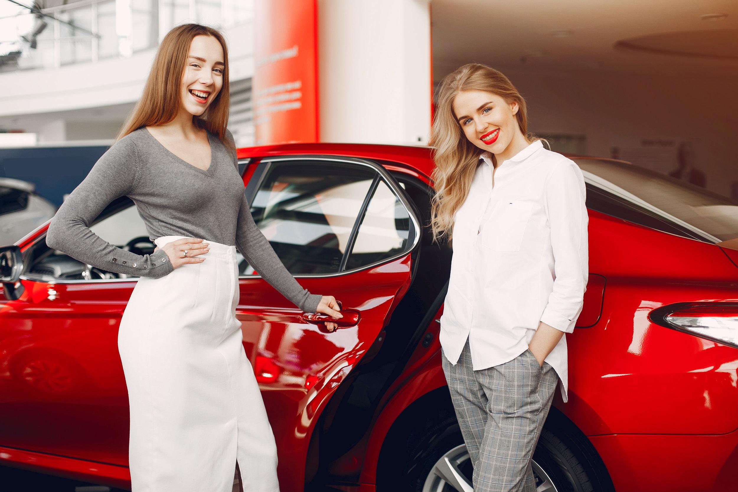 two-stylish-women-in-a-car-salon-GVR964D.jpg