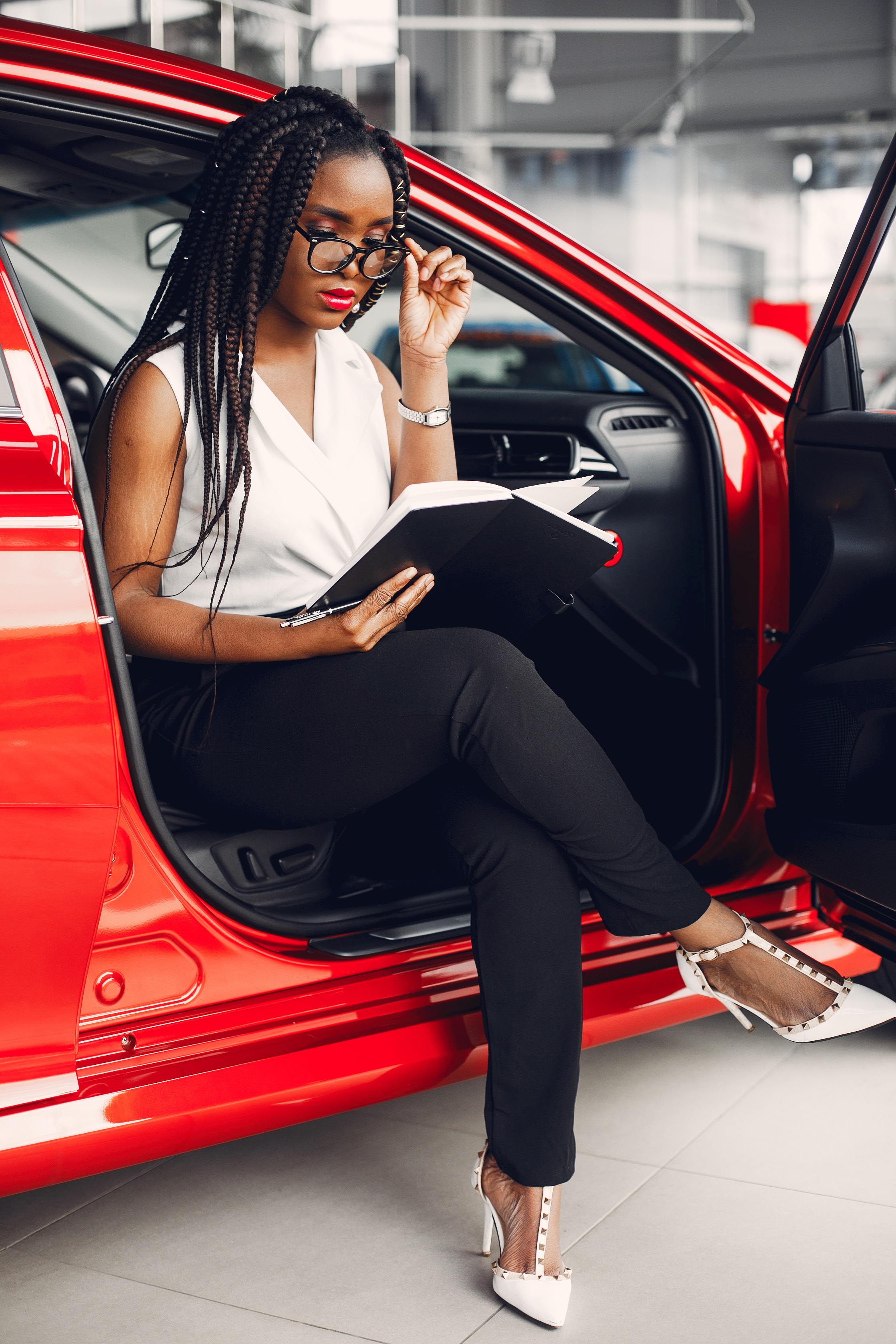 stylish-black-woman-in-a-car-salon-B8CK7FE.jpg