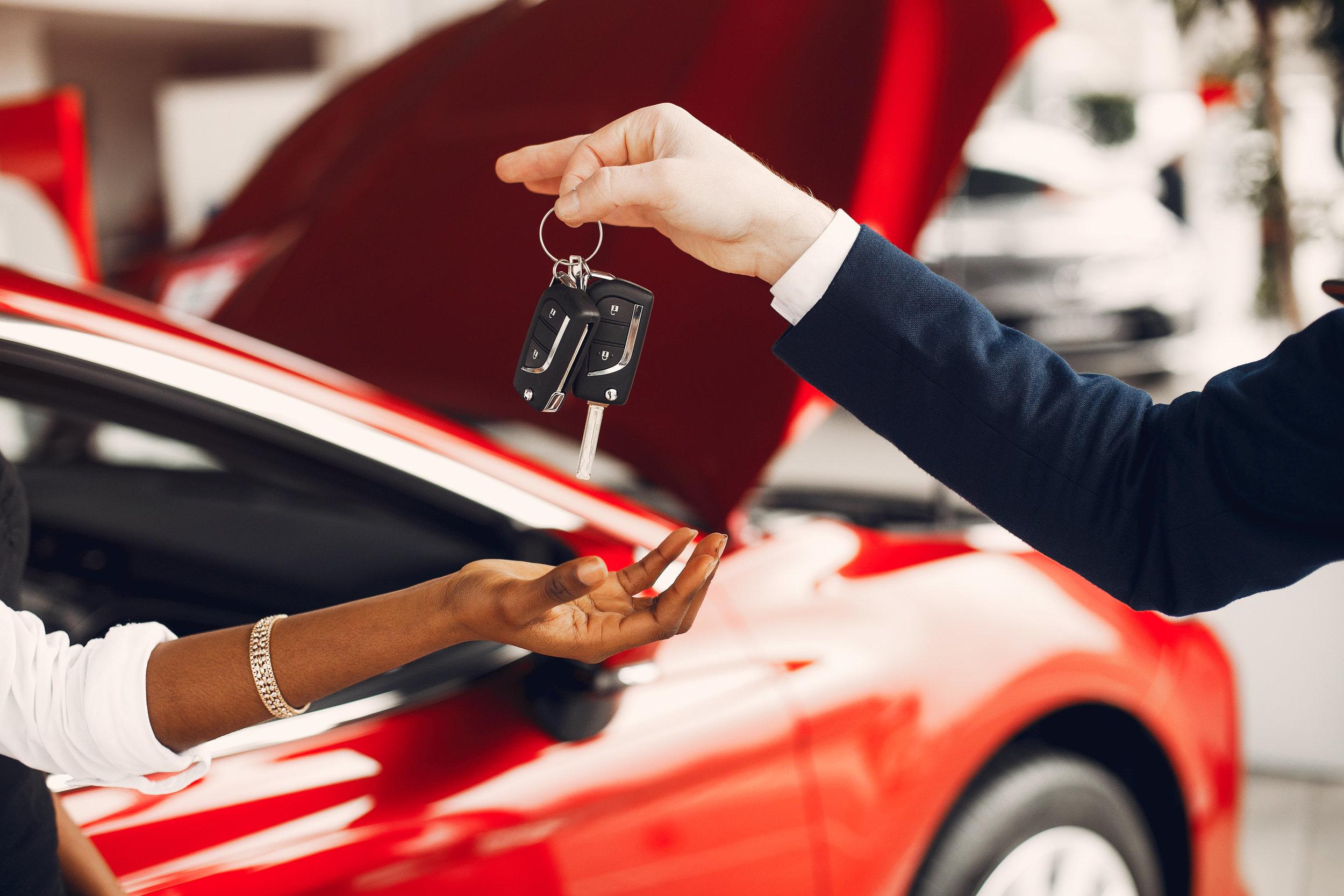 stylish-black-woman-in-a-car-salon-JWUSHD4.jpg