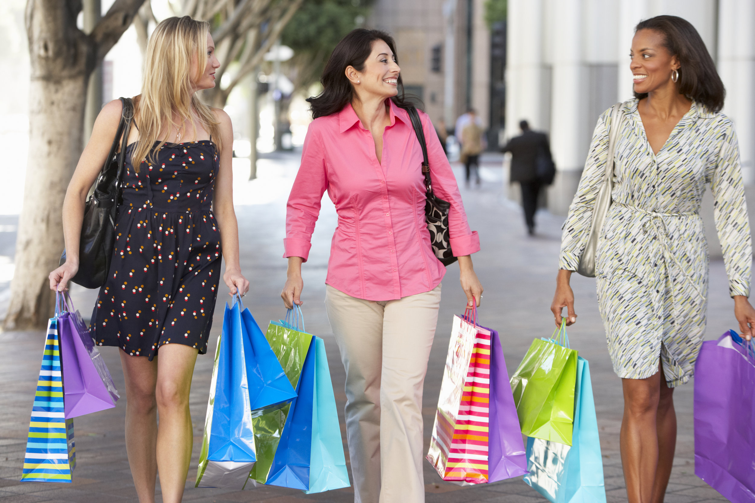 group-of-women-carrying-shopping-bags-on-city-PNPSDGZ.jpg