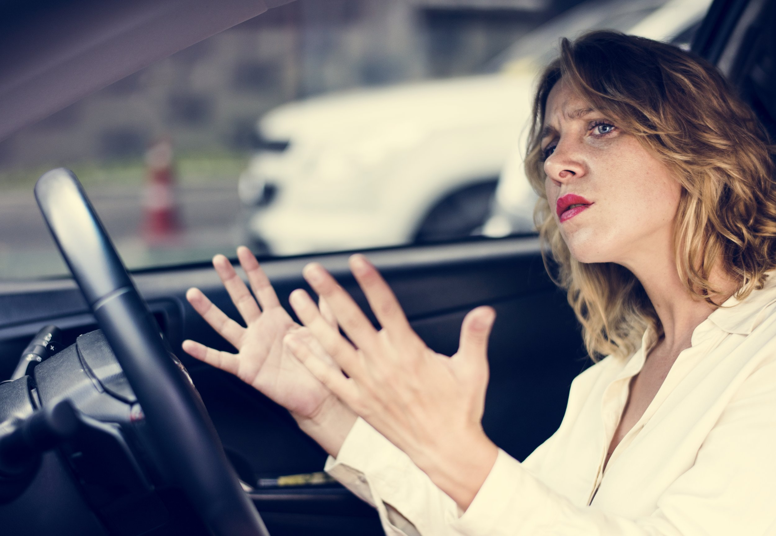 frustrated-woman-stuck-in-traffic-BG436YH.jpg