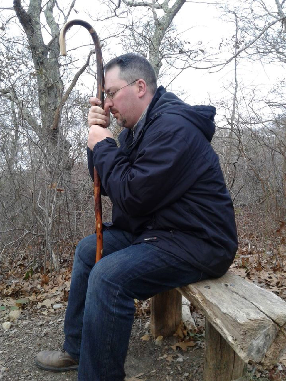 A capture of my husband in prayer as he rests on the trail...