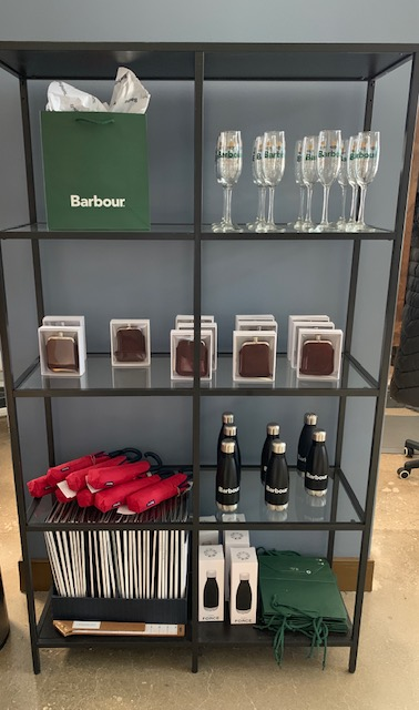 Barbour and QG teamed up to give champagne flutes, water bottles, umbrellas, and flasks as gifts with purchase.