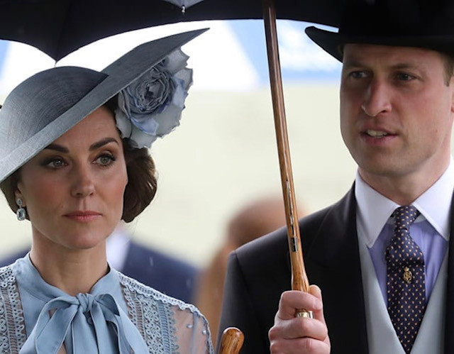 Prince William and Catherine, The Duke and Duchess of Cambridge receiving cover from a Fox umbrella