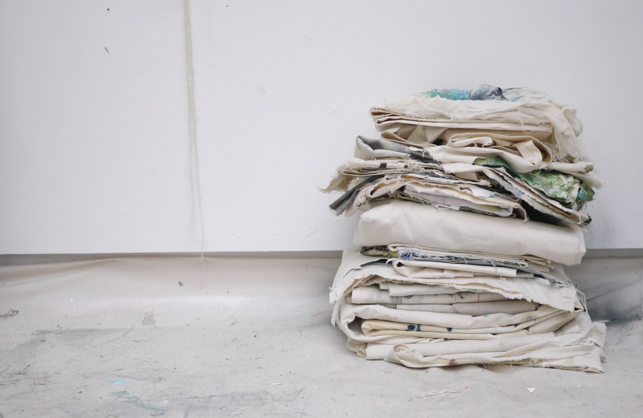 Ally McGinn (2017) Pile  [Ongoing performance]. 'Found' canvas. Size varies daily  While piling or shaping the canvas challenges both our reading of 'painting' and notions of value in painting.   By exposing the canvas to a non-permanent form we question its value as an object. Performance without the artist.