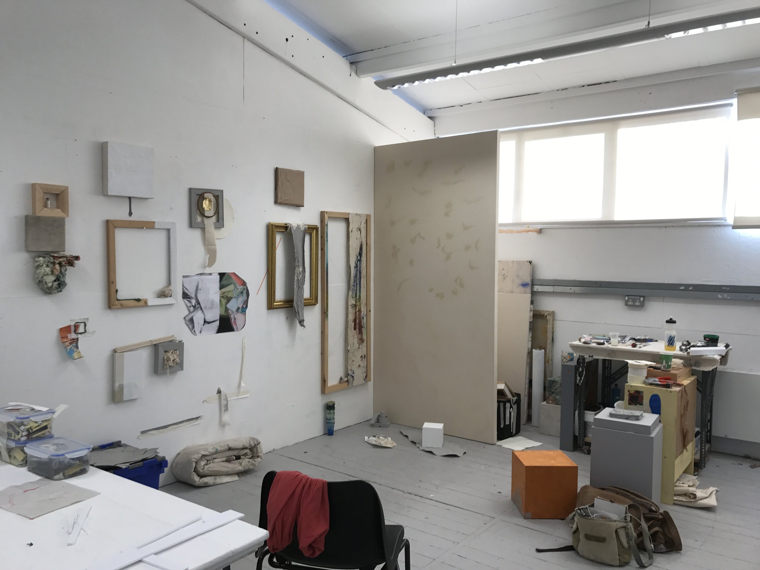 Ally McGinn (2017) [Studio documentation].  Studio View - Wednesday 25th, 11am - The wall is no longer a wall. Now it is a painting.  Ive extended the space behind the wall, and reinforced it. Im reluctant to screw through the canvas, yet.