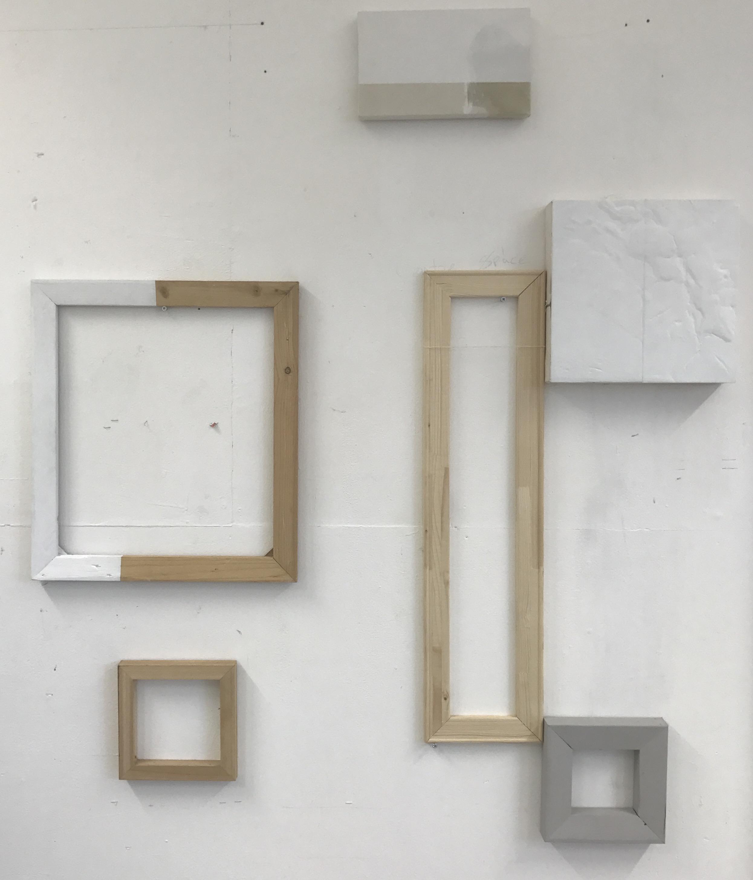 Ally McGinn (2017) Studio view.  Empty frames with a balanced aesthetic.