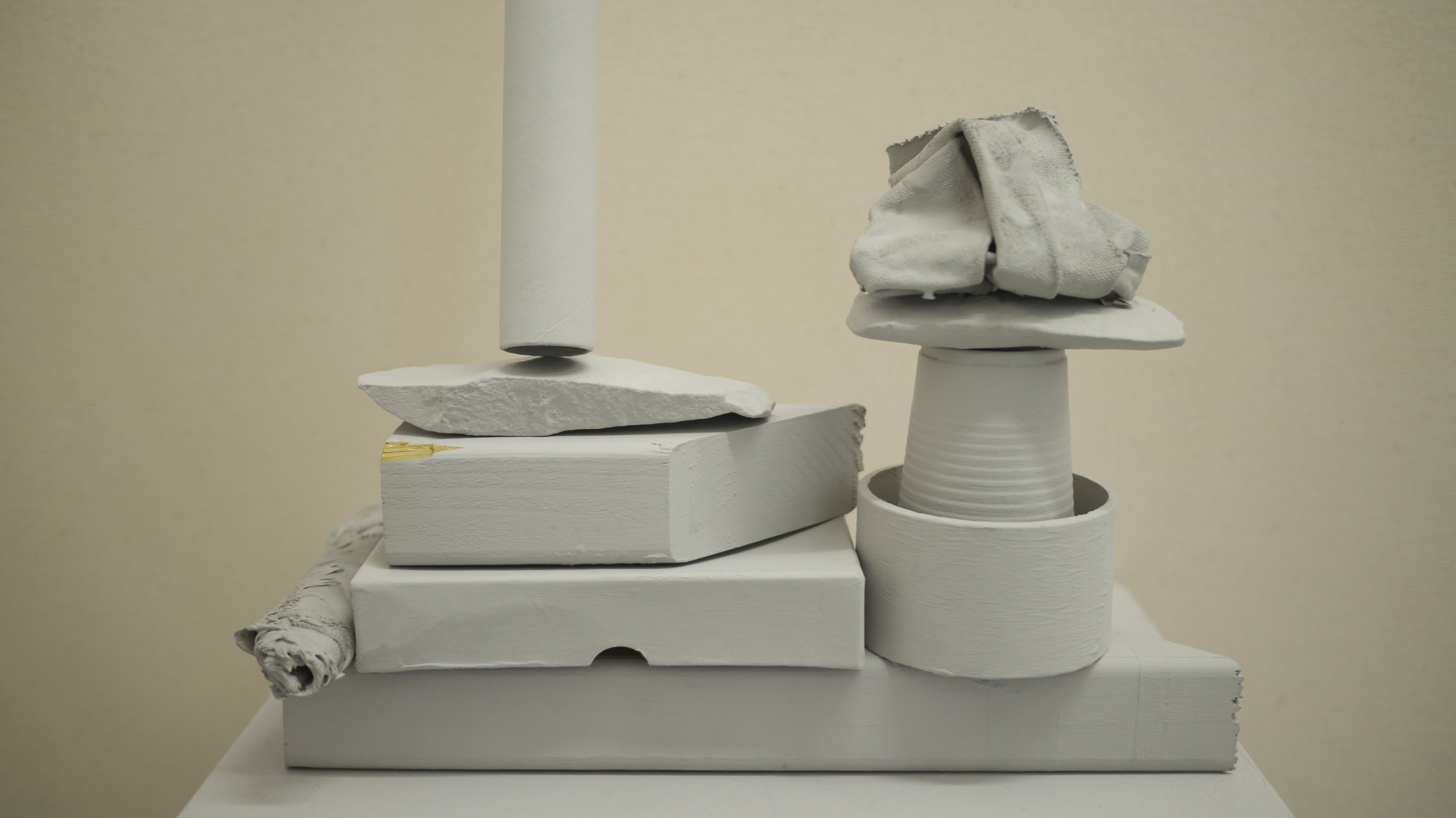 Ally McGinn (2017) The equalising qualities of grey painting [Studio view].  Objects of various values, purposes and associations, equalised through process and a reduction of their primary qualities.