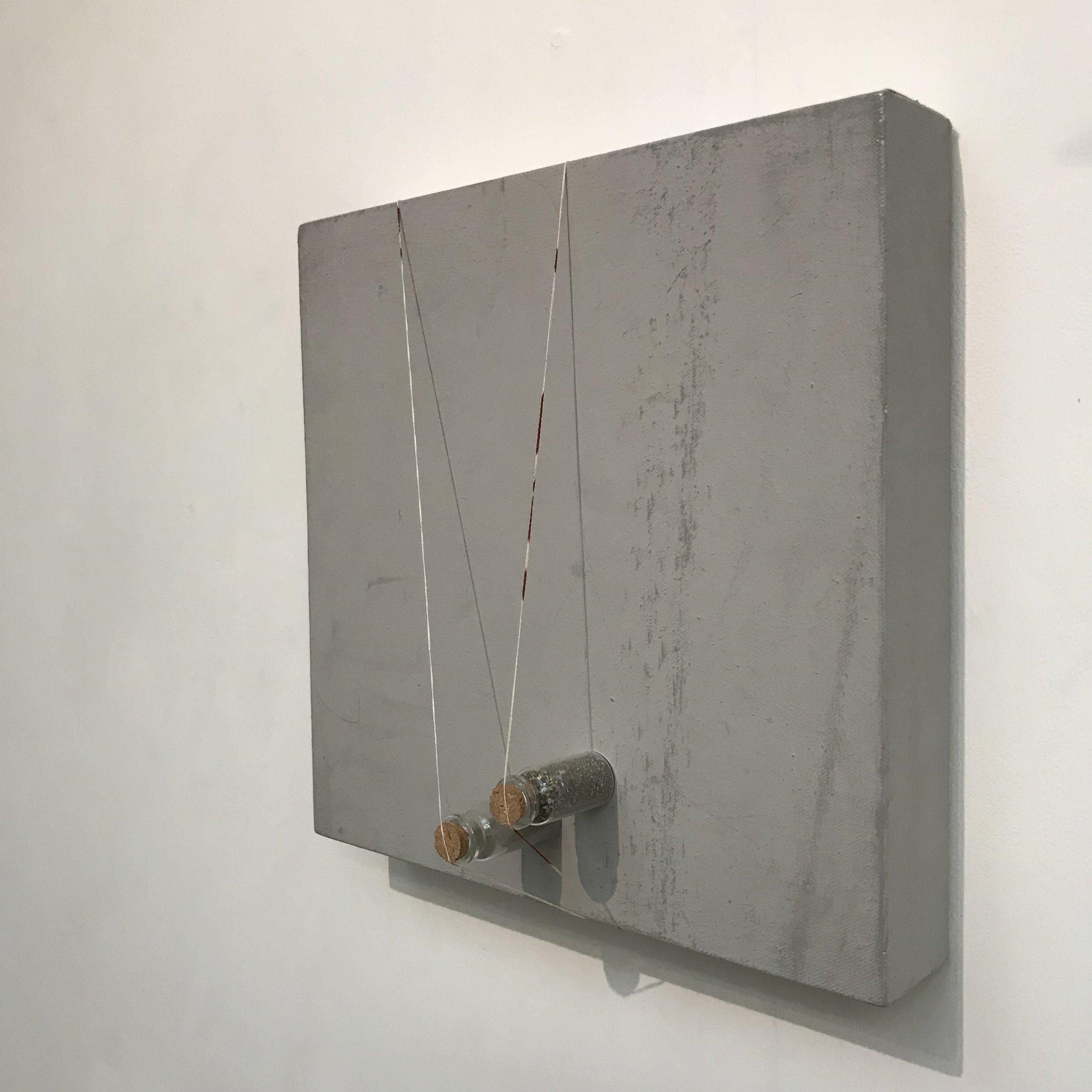 Floor (2018) Dust, bottles, canvas thread, grey paint and marks. 40 x 40 x 6 cmJPG.JPG