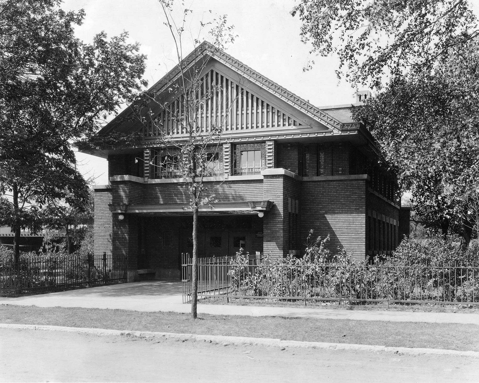 William Drummond, who worked for several years under architect Frank Lloyd Wright, designed Shedd Park's field house, ca. 1920.