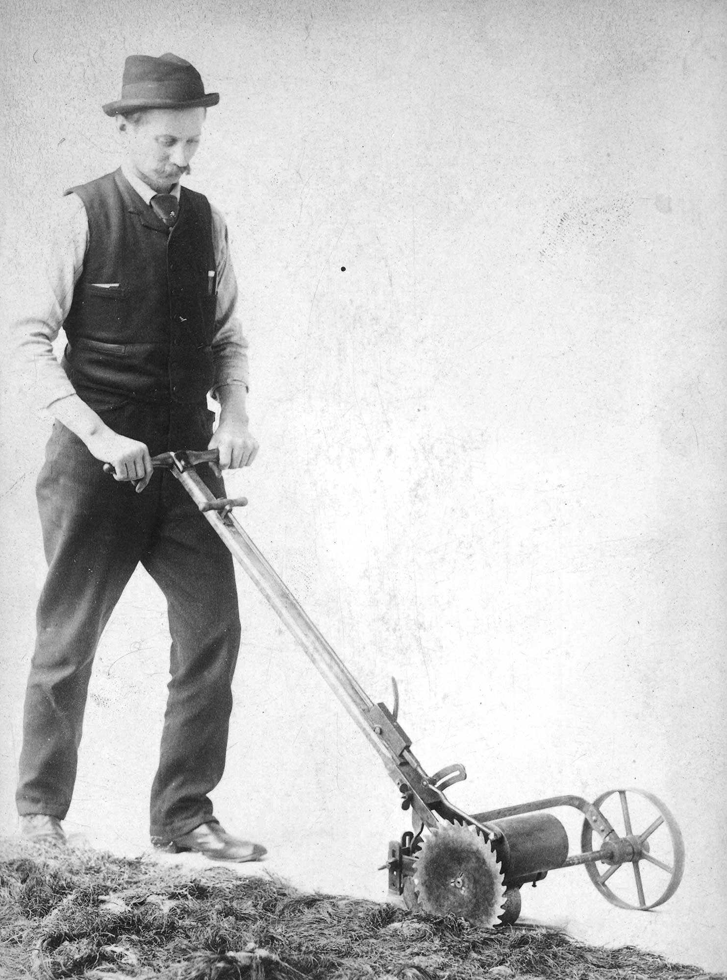 This portrait of Jensen edging the lawn shows the great pride he took in every aspect of his work. Ca. 1895, courtesy of the Johnson, Jensen, and Wheeler families.