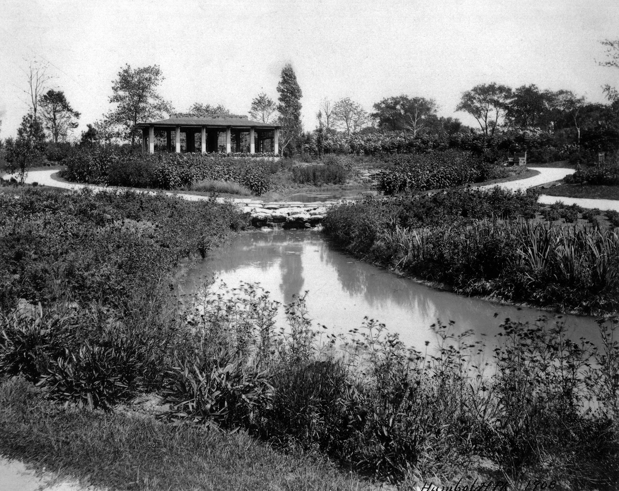 Looking northwest from the fork in Prairie River, this view shows the Japanese tea house which remained for at least 50 years. 1908, Chicago Park District Records: Photographs, Special Collections, Chicago Public Library.