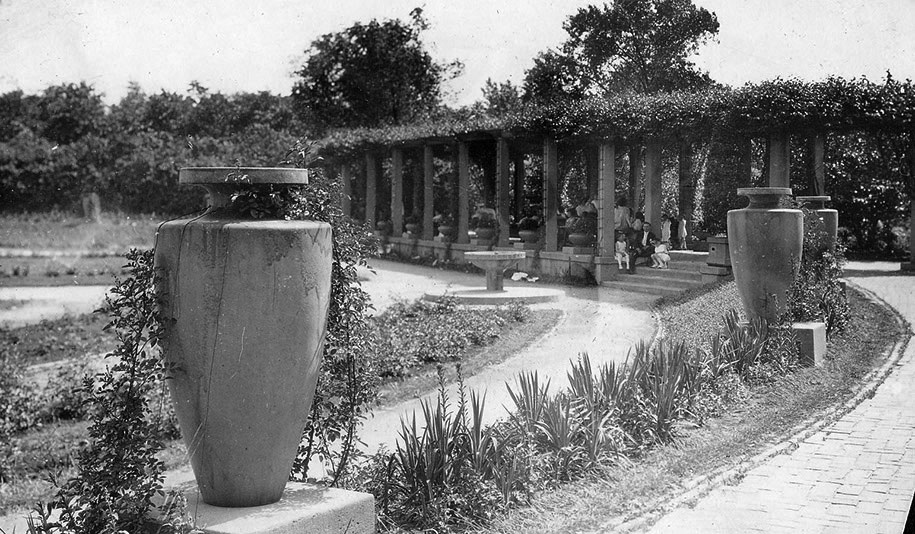 In this photograph, you can see park visitors relaxing under the garden's west pergola, ca. 1915. Chicago Park District Records: Photographs, Special Collections, Chicago Public Library.