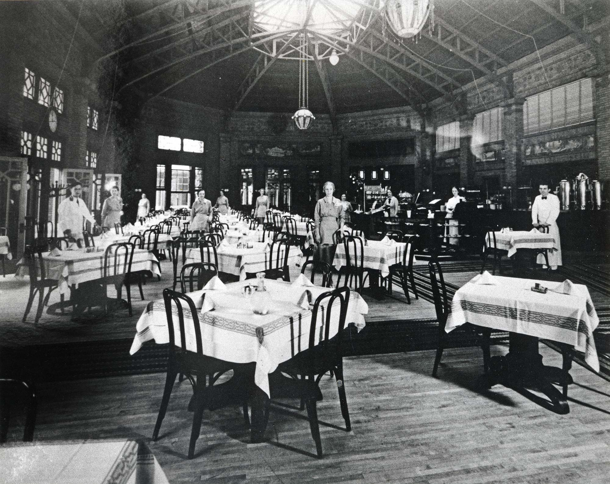 View of the Café Brauer restaurant in Great Hall with waiters and waitresses, ca. 1925.