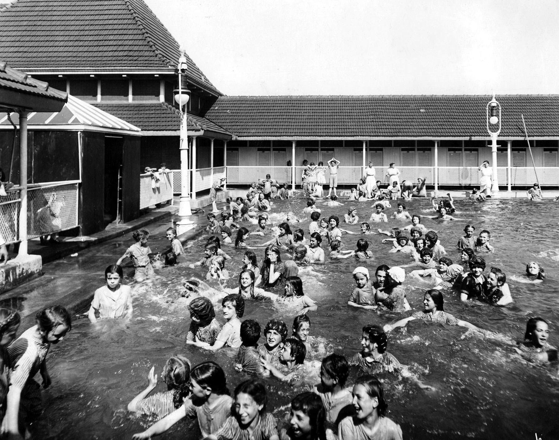 With separate pools for men and women, the 1896 Douglas Park natatorium was the first swimming facility in Chicago's parks. This photo of the women's pool dates to 1914.  Chicago Public Library Special Collections, Chicago Park District Archives, Photos.