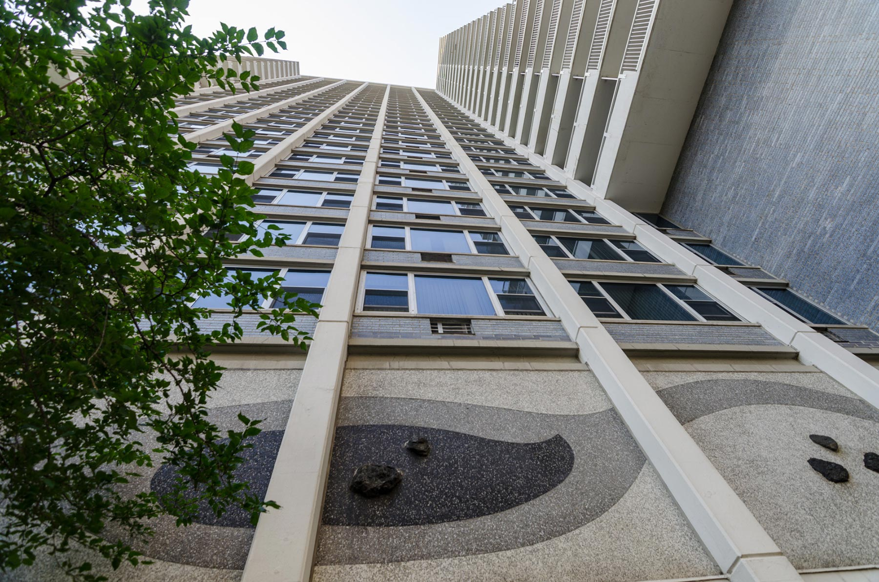 "The Imperial Towers is a Mid-Century Modern high-rise with a ""Far Eastern"" flair. The swirling, abstract forms of its mosaic panels represent Japanese garden elements. Photo by Eric Allix Rogers."