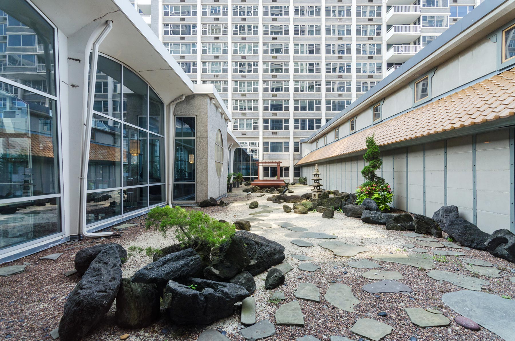 The Japanese dry-garden is tucked behind the glassy lobby. Photo by Eric Allix Rogers.