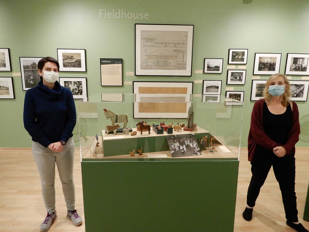 Johanna Russ and I are shown here standing in the section of the exhibit that explores the history of the fieldhouse, a building type invented in Chicago's parks. Handmade toys in the vitrine between us came from a toy lending library in one of the fieldhouses.