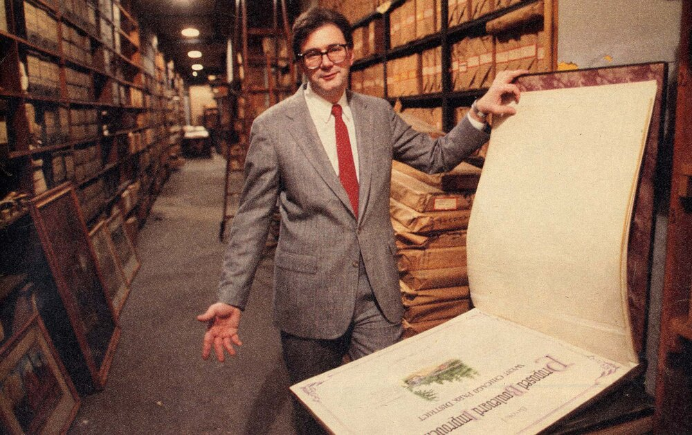 "Ed Uhlir showing artifacts in the sub-basement vault. From ""Hidden Treasures: A Cache of Historic Blueprints Could Usher in Another Golden Age for Chicago's Parks,""  Chicago Tribune,  March 22, 1987."