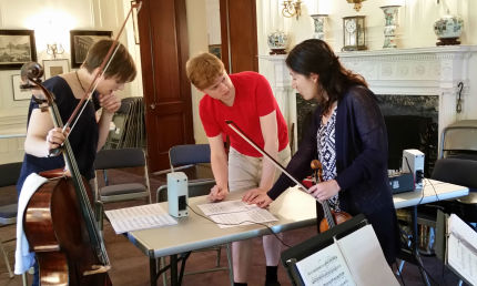"""Michael works on  """"a sky a silver""""  with cellist Alexis Gerlach and violinist Harumi Rhodes."""