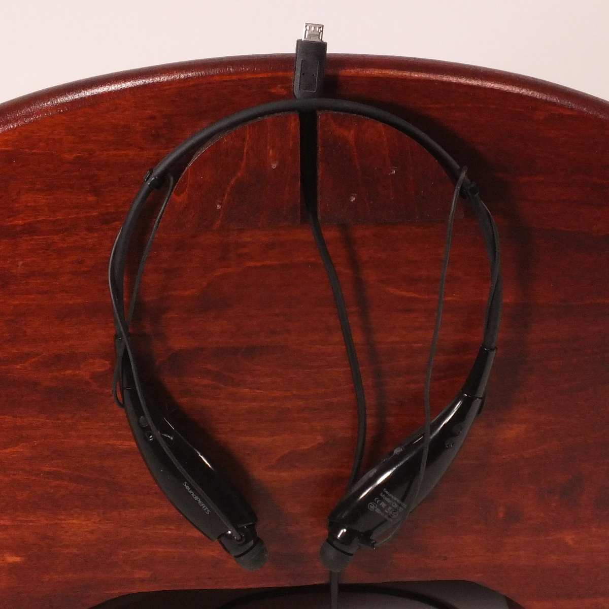 Earbud / Neckband Holder shown here on the back of a Trundle Tech Bed