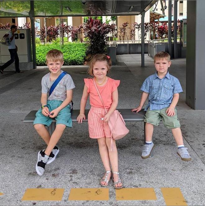 Kids waiting for public transit