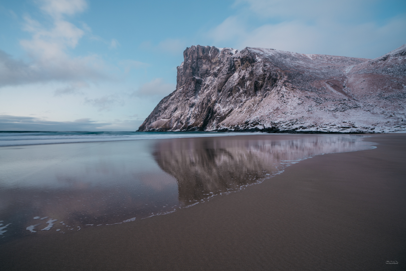 Amazing reflections in the wet surface of Kvalvika Beach